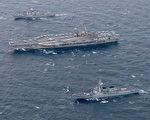 11月11日開始,美韓海軍開始在朝鮮半島海域聯合海軍演習,美軍派遣三艘航空母艦戰斗群參加軍演,這是時隔10年來首次。圖為里根號航母。(AFP PHOTO / US NAVY / MC2 Kenneth ABBATE)