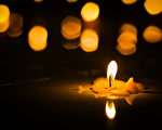 light a candle in the dark