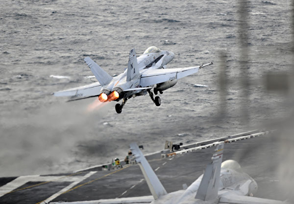 171111-N-KB563-1237 PACIFIC OCEAN (Nov. 11, 2017) An F/A-18E Super Hornet, assigned to the Stingers of Strike Fighter Attack Squadron (VFA) 113, launches from the flight deck of the aircraft carrier USS Theodore Roosevelt (CVN 71) in the western Pacific Ocean. Aircraft carriers, Theodore Roosevelt, Ronald Reagan, and Nimitz strike groups are underway conducting flight operations in international waters as part of a three-carrier strike force exercise. The U.S. Pacific Fleet has patrolled the Indo-Pacific region routinely for more than 70 years promoting regional security, stability and prosperity. (U.S. Navy photo by Mass Communication Specialist 1st Class Michael Russell/Released)