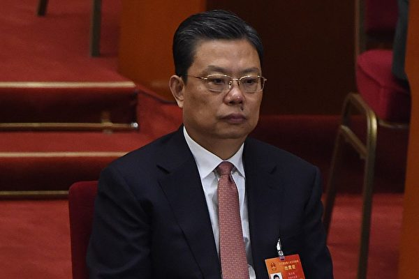 "Zhao Leji, a member of the Political Bureau of the 18th Communist Party of China (CPC) Central Committee, attends the closing of the 3rd Session of the 12th National People's Congress at the Great Hall of the People in Beijing on March 15, 2015. China's Communist Party-controlled legislature, the National People's Congress (NPC), gathers in the capital for the annual show of political theater, with the ""rule of law"" high on the agenda.     AFP PHOTO / WANG ZHAO        (Photo credit should read WANG ZHAO/AFP/Getty Images)"