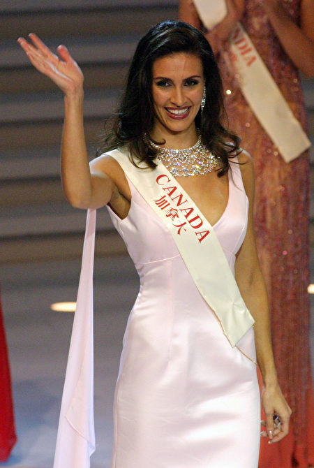 HAINAN, CHINA - DECEMBER 6: Miss Canada Nazanin Afshin-Jam, a finalist in this year's Miss World contest, on stage on December 6 2003 in Hainan, China. The live show was watched by a worldwide TV audience and for the first time allowed the public to vote for their favorite contestant using the internet. (Photo by Getty Images)