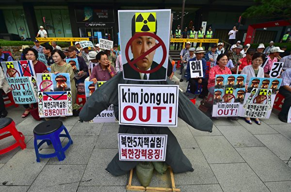 去年9月韓國民眾抗議朝鮮核試驗。 (Photo credit should read JUNG YEON-JE/AFP/Getty Images)