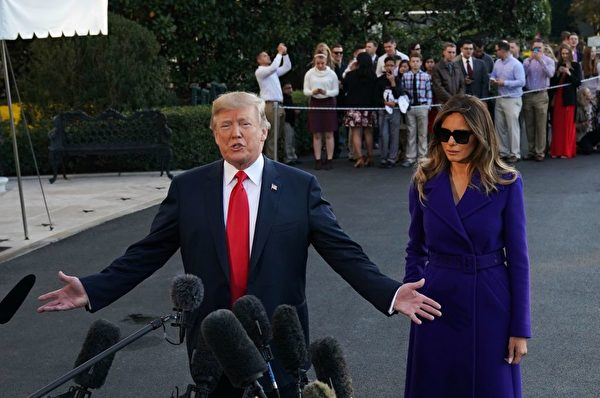 US President Donald Trump and First Lady Melania Trump speak to the press as they make their way to board Marine One before departing from the South Lawn of the White House on November 3, 2017 in Washington, embarking on a 11-day tour of Asia. / AFP PHOTO / MANDEL NGAN (Photo credit should read MANDEL NGAN/AFP/Getty Images)