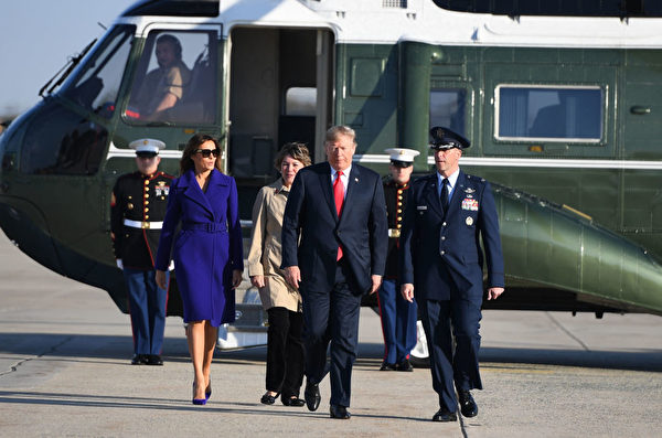 US President Donald Trump and First Lady Melania Trump make their way to board Air Force One departing from Andrews Air Force Base, Maryland on November 3, 2017, embarking on a 11-day tour of Asia. / AFP PHOTO / JIM WATSON (Photo credit should read JIM WATSON/AFP/Getty Images)