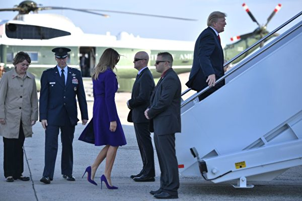 US President Donald Trump and First Lady Melania Trump board Air Force One departing from Andrews Air Force Base, Maryland on November 3, 2017, embarking on a 11-day tour of Asia. / AFP PHOTO / JIM WATSON (Photo credit should read JIM WATSON/AFP/Getty Images)