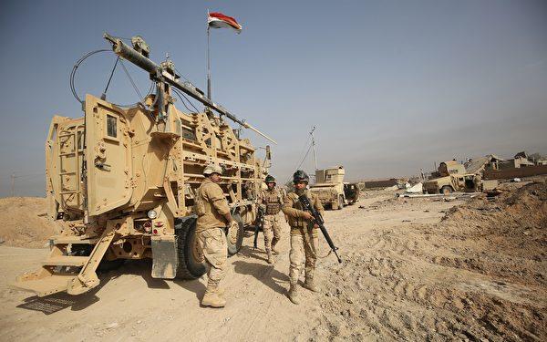 伊拉克總理阿巴迪(Haidar Abadi)宣布,政府軍占領了伊拉克邊界城鎮加伊姆(al-Qaim)。(AHMAD AL-RUBAYE/AFP/Getty Images)
