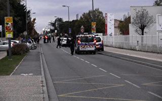 11月10日(週五)下午,3名中國留學生在法國南部圖盧茲市(Toulouse)郊區布拉尼亞克鎮(Blagnac)被一名男子駕車有意撞傷,其中1人受傷嚴重。圖為警方在事發現場進行調查。(HUGUES JEANNEAU / AFP TV/AFP/Getty Images)