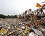 大陆社会乱象愈演愈乱,不断突破道德底线。图为11月26日宁波江北突发爆炸,现场房屋坍塌。(STR/AFP/Getty Images)