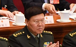中共前政治工作部主任張陽(左)在調查期間被指自縊死亡。(GREG BAKER/AFP/Getty Images)