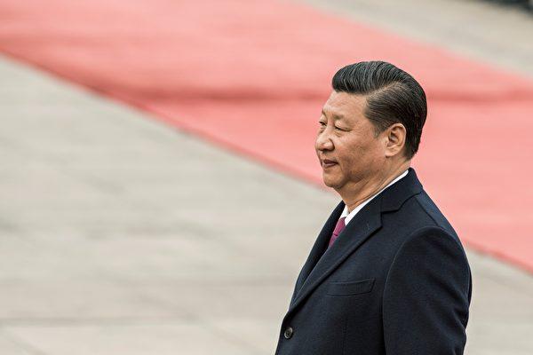 习近平反腐以来党政军遭整肃的大老虎,均有江派背景。(FRED DUFOUR/AFP/Getty Images)