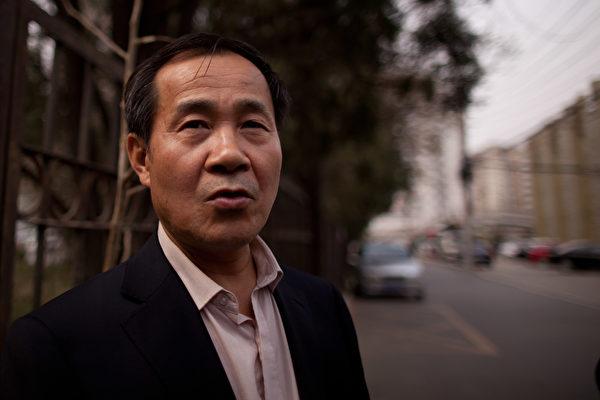 大陸人權律師程海所在的律師事務所近日被中共註銷。程海表示該決定違法。圖為程海律師。 (Ed Jones/AFP/Getty Images)