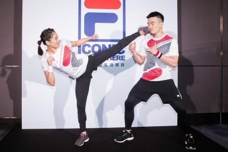 台湾空手道好手文姿云(左)28日与教练徐玮骏(右)出席赞助商新品发表会,并示范空手道技巧,文姿云不小心踢到教练的脸。