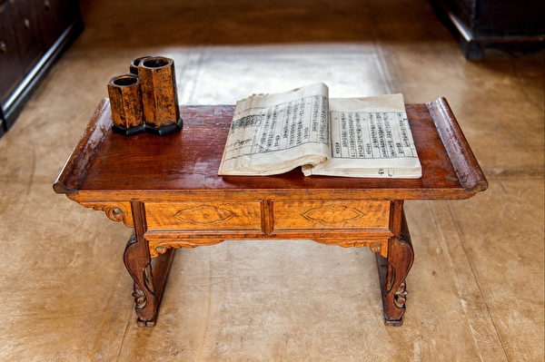Old chinese book on wooden table.
