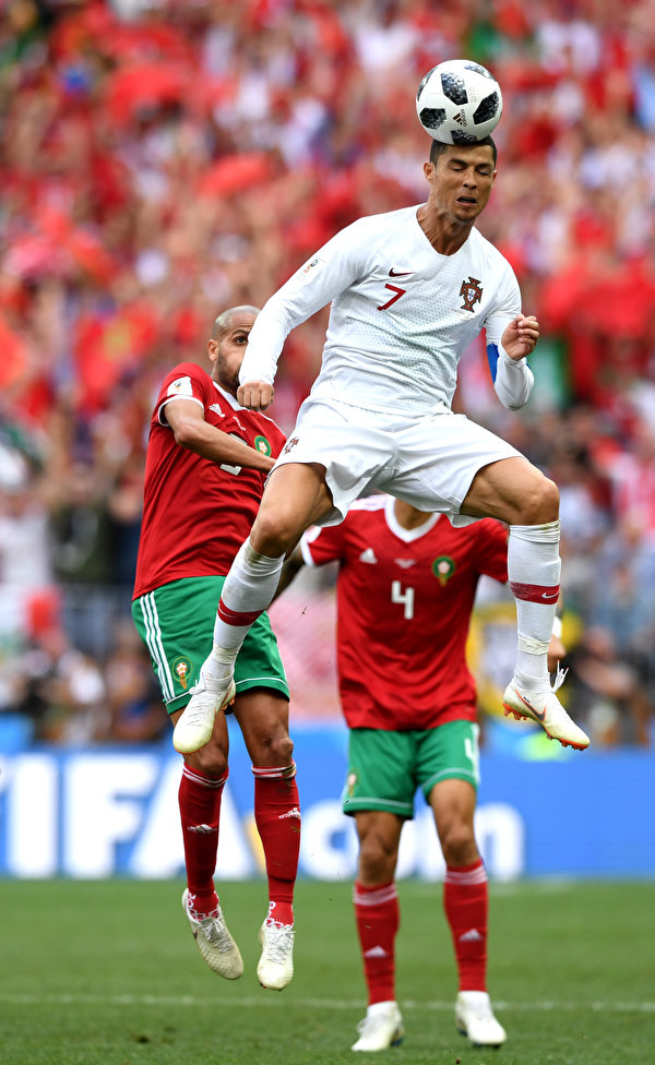 MOSCOW, RUSSIA - JUNE 20: Cristiano Ronaldo of Portugal heads the ball during the 2018 FIFA World Cup Russia group B match between Portugal and Morocco at Luzhniki Stadium on June 20, 2018 in Moscow, Russia.