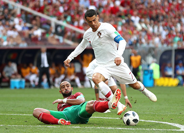 MOSCOW, RUSSIA - JUNE 20: Cristiano Ronaldo of Portugal is fouled by Mehdi Benatia of Morocco just outside the box during the 2018 FIFA World Cup Russia group B match between Portugal and Morocco at Luzhniki Stadium on June 20, 2018 in Moscow, Russia.