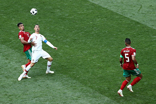 MOSCOW, RUSSIA - JUNE 20: Nabil Dirar of Morocco tackles Cristiano Ronaldo of Portugal during the 2018 FIFA World Cup Russia group B match between Portugal and Morocco at Luzhniki Stadium on June 20, 2018 in Moscow, Russia.
