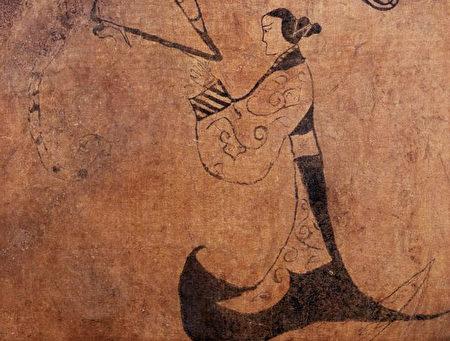 楚文王在丹地得到美人,一时纵情声色,以致一年都没有上朝,国事荒废。图为战国时期人物龙凤帛画局部,湖南省博物馆藏品。(公有领域)