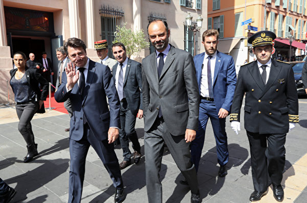 French Prime Minister Edouard Philippe (C) walks with The Mayor of Nice Christian Estrosi (C/L) as he arrives in Nice on July 14, 2018, to attend a ceremony for the second anniversary of attacks on the French coastal city in which 86 people died when a truck was driven into a crowd celebrating Bastille Day on the Promenade des Anglais. France is deploying 110,000 police and security forces nationwide this weekend to secure the huge street parties if the national team win the World Cup on July 15. The country has been repeatedly targeted by extremists over previous years in attacks that have claimed 246 lives since January 2015, according to an AFP toll.