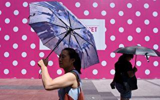 近日,北京持续高温,6月29日,局地高温达43.4℃。图为高温下的北京。(WANG ZHAO/AFP/Getty Images)