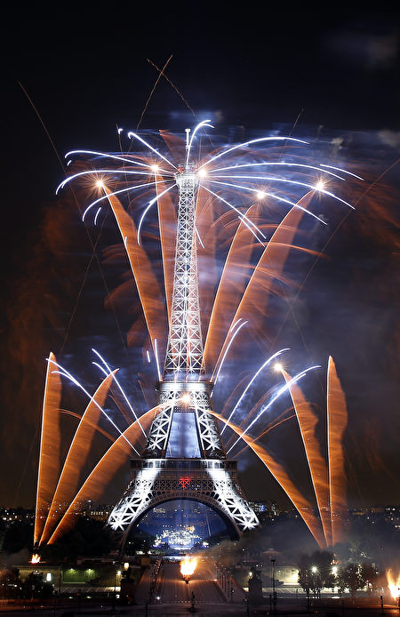 PARIS, FRANCE - JULY 14: Fireworks burst around the Eiffel Tower as part of Bastille Day celebrations on July 14, 2018 in Paris, France. The theme of the fireworks of this year is dedicated to the romanticism.