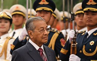 马哈蒂尔访华要求公平贸易 反对新殖民主义