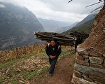 圖為四川山區的農民。(Guang Niu/Getty Images)