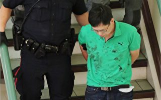 A blood covered man is escorted in handcuffs form a stabbing incident in the Perpetual Wellness Chinese Medicine Centre on Thursday June 16, 2016 Gavin Young/Postmedia