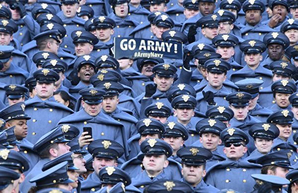 TOPSHOT - US Military Academy (USMA) show their support prior to the annual Army-Navy football game at Lincoln Financial Field in Philadelphia, Pennsylvania, December 8, 2018. - Trump will officiate the coin toss at Lincoln Financial Field in Philadelphia between the Army Black Knights of the US Military Academy (USMA) and the Navy Midshipmen of the US Naval Academy (USNA). (Photo by Jim WATSON / AFP)        (Photo credit should read JIM WATSON/AFP/Getty Images)