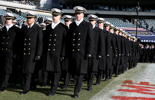 PHILADELPHIA, PENNSYLVANIA - DECEMBER 08:  The Naval cadets march on the field before the game between the Army Black Knights and the Navy Midshipmen at Lincoln Financial Field on December 08, 2018 in Philadelphia, Pennsylvania. (Photo by Elsa/Getty Images)