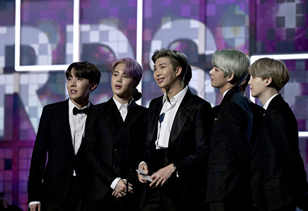 BTS speak onstage during the 61st Annual GRAMMY Awards
