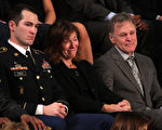 WASHINGTON, DC - JANUARY 30: Army Staff Sergeant Justin Peck sits with Fred and Cindy Warmbier during the State of the Union address in the chamber of the U.S. House of Representatives January 30, 2018 in Washington, DC. This is the first State of the Union address given by U.S. President Donald Trump and his second joint-session address to Congress. (Photo by Alex Wong/Getty Images)