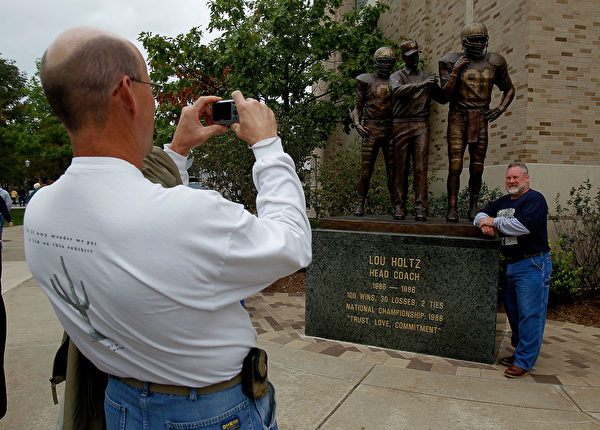 SOUTH BEND, IN - SEPTEMBER 25: Fans take pictures in front of a statue of former head coach Lou Holtz of the Notre Dame Fighting Irish before a game against the Stanford Cardinal at Notre Dame Stadium on September 25, 2010 in South Bend, Indiana. (Photo by Jonathan Daniel/Getty Images)