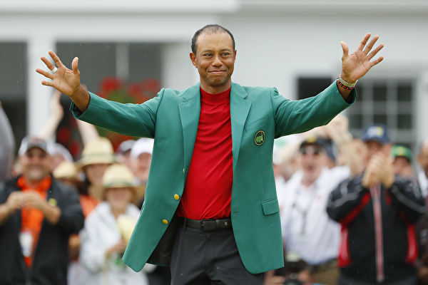 AUGUSTA, GEORGIA - APRIL 14: Tiger Woods of the United States reacts after being awarded the Green Jacket during the Green Jacket Ceremony after winning the Masters at Augusta National Golf Club on April 14, 2019 in Augusta, Georgia. (Photo by Kevin C. Cox/Getty Images)