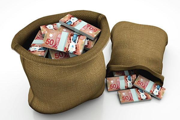 卑詩省最新發表的洗錢報告稱,去年約有53億加元黑錢流入省內房地產業,被洗白的同時將卑詩房價上抬了5%左右。(Shutterstock)