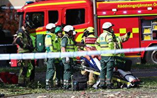 救援人员和消防员6月7日上午在瑞典林雪平镇发生爆炸袭击的公寓楼外工作。(Jeppe Gustafsson/AFP/Getty Images)