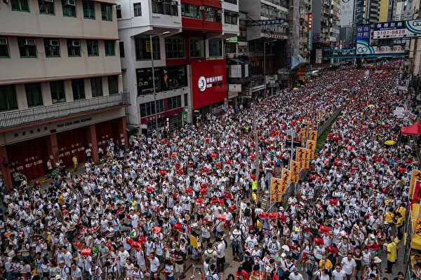 HONG KONG, HONG KONG - JUNE 09: Protesters march on a street during a rally against the extradition law proposal on June 9, 2019 in Hong Kong China. Hundreds of thousands of protesters marched in Hong Kong in Sunday against a controversial extradition bill that would allow suspected criminals to be sent to mainland China for trial.(Photo by
