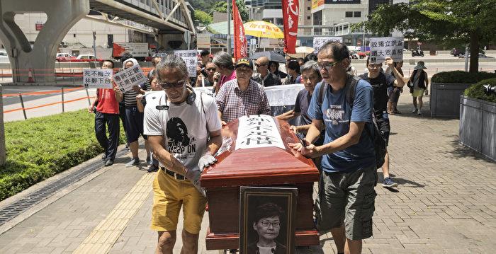 香港社民連抬真棺材抗議特首拒撤回惡法