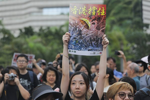 Protesters gather before a march to the West Kowloon railway station, where high-speed trains depart for the Chinese mainland, during a demonstration against a proposed extradition bill in Hong Kong on July 7, 2019. - Hong Kong has been rocked by a month of huge peaceful protests as well as a series of separate violent youth-led confrontations sparked by a proposed law that would have allowed extraditions to mainland China. (Photo by Vivek PRAKASH / AFP) (Photo credit should read