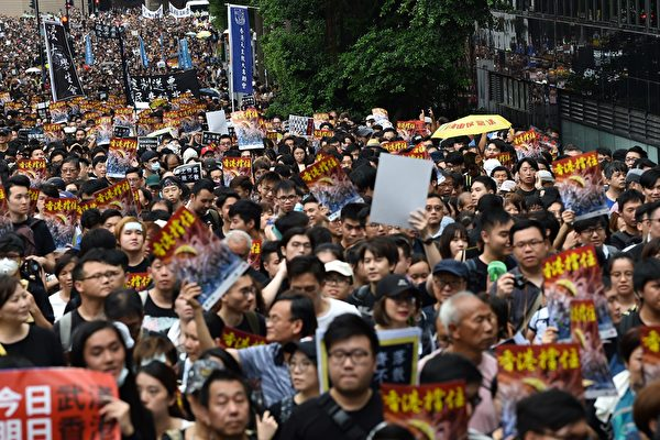 Protesters take part in a march to the West Kowloon railway station during a demonstration against a proposed extradition bill in Hong Kong on July 7, 2019. - Thousands of anti-government protesters began a march in Hong Kong on July 7 that will end outside a controversial train station linking the territory to the Chinese mainland, as activists try to keep pressure on the city's pro-Beijing leaders. (Photo by Hector RETAMAL / AFP) (Photo credit should read