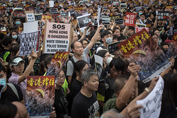 HONG KONG, HONG KONG - JULY 07: Protesters march towards the West Kowloon railway station during a protest against the proposed extradition bill on July 7, 2019. in Hong Kong, China. Thousands of protesters marched to the train station which links Hong Kong to the Chinese mainland. Pro-democracy demonstrations have continued on the streets of Hong Kong for the past month, calling for the complete withdrawal of a controversial extradition bill. Hong Kong's Chief Executive Carrie Lam has suspended the bill indefinitely, however protests have continued with demonstrators now calling for her resignation. (Photo by