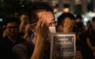 組圖:香港重光紀念日 港民掩右眼默站