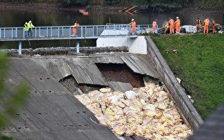 堤坝破损 英国小镇居民被迫离家一周