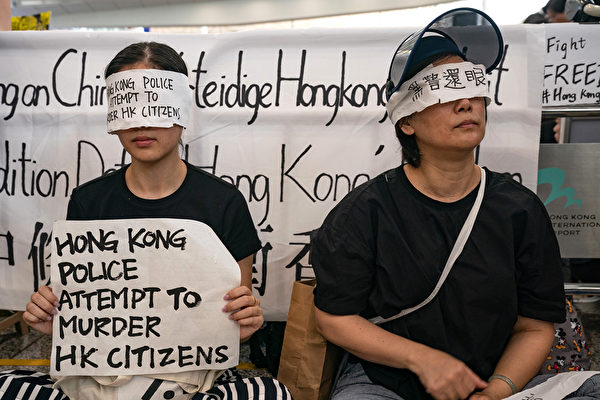 "August 12, 2019 in Hong Kong, China. Pro-democracy protesters have continued rallies on the streets of Hong Kong against a controversial extradition bill since 9 June as the city plunged into crisis after waves of demonstrations and several violent clashes. Hong Kong's Chief Executive Carrie Lam apologized for introducing the bill and declared it ""dead"", however protesters have continued to draw large crowds with demands for Lam's resignation and completely withdraw the bill. (Photo by"