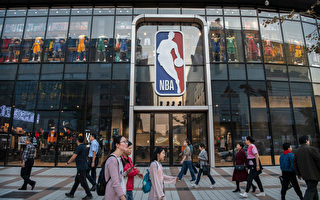 BEIJING, CHINA - OCTOBER 09: People walk by the NBA flagship retail store on October 9, 2019 in Beijing, China. The NBA is trying to salvage its brand in China amid criticism of its handling of a controversial tweet that infuriated the government and has jeopardized the leagues Chinese expansion. The crisis, triggered by a Houston Rockets executives tweet that praised protests in Hong Kong, prompted the Chinese Basketball Association to suspend its partnership with the league. The backlash continued with state-owned television CCTV scrapping its plans to broadcast pre-season games in Shanghai and Shenzhen, and the cancellation of other promotional fan events. The league issued an apology, though NBA Commissioner Adam Silver angered Chinese officials further when he defended the right of players and team executives to free speech. China represents a lucrative market for the NBA, which stands to lose millions of dollars in revenue and threatens to alienate Chinese fans. Many have taken to Chinas social media platforms to express their outrage and disappointment that the NBA would question the countrys sovereignty over Hong Kong which has been mired in anti-government protests since June.(Photo by Kevin Frayer/Getty Images)