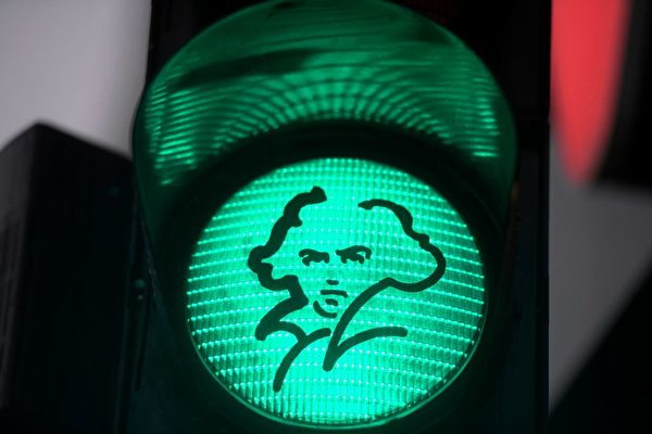 "A green traffic light with the portrait of German composer Ludwig van Beethoven is pictured in his native city of Bonn, western Germany, on December 13, 2019. - Germany is starting into the ""Beethoven-Year"" with more than 700 events to celebrate the 250th anniversary of Ludwig van Beethoven's birth. (Photo by INA FASSBENDER / AFP) (Photo by INA FASSBENDER/AFP via Getty Images)"