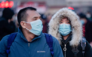 武漢肺癌疫情的病例,為何從1月19日開始激增?(Kevin Frayer/Getty Images)