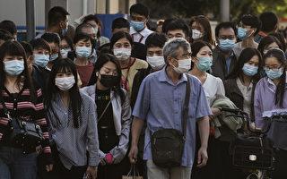 中共病毒造成中国至少8万人确诊。由于中共官方隐瞒疫情,外界认为实际感染人数更多。(Kevin Frayer/Getty Images)