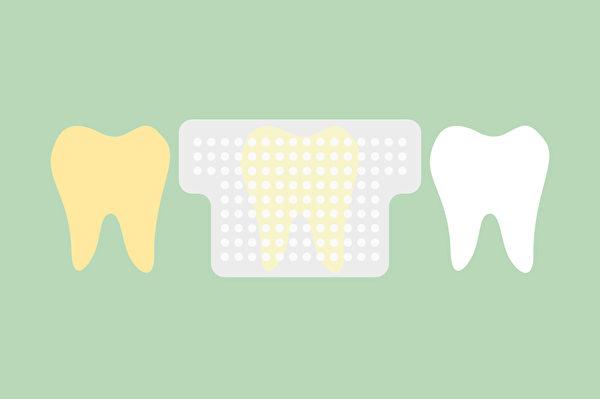 美白牙貼大多包含上下牙各1片的透明貼片,貼在牙齒上,會讓牙齒變白。(Shutterstock)