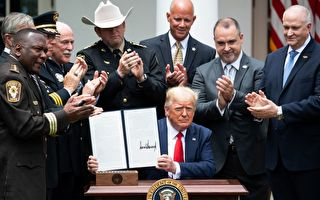 US President Donald Trump shows his signature on an Executive Order on Safe Policing for Safe Communities, in the Rose Garden of the White House in Washington, DC, June 16, 2020. (Photo by SAUL LOEB / AFP) (Photo by SAUL LOEB/AFP via Getty Images)