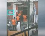 網傳視頻顯示,樓門疑似為「520號」。(視頻截圖)